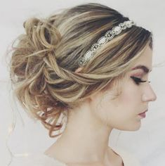 Hair for prom. Rhinestone headband to pop of from the curly hair in a bun because the dress come up to you neck and if you wear your hair down you won't be able to see the top of the dress.