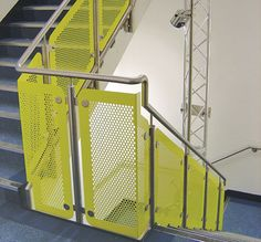Stainless-steel handrail and balustrade to internal stairs complete with polyester powder-coated perforated infill panels
