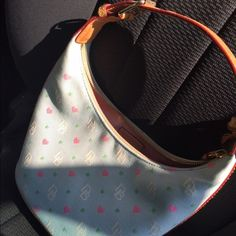 Dooney & Bourke purse New without tags authentic Dooney & Bourke purse; Easter green with pastel colored hearts and design; brown handle (no long handles) Dooney & Bourke Other