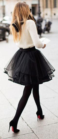 cozy white sweater paired with fluffy skirt, black tights, classic pumps and fur black scarf