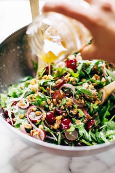 Arugula Salad with Grapes and Black Pepper Vinaigrette - a healthy recipe that is packed with flavor! Simple ingredients like grapes, arugula, cashews, and picked red onions. Vegetarian / vegan / gluten free. | pinchofyum.com