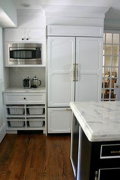 Microwave next to fridge