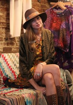 Good outfits for casual hippie concerts: Sundress, high boots, warm cute sweater, hat and lots of accessories.