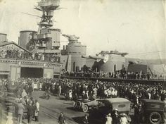 15 in battlecruiser HMS Hood visiting New Zealand, 1936. Dating from WW1, and only mildly modernised since, she was by then ageing: modern German battleship Bismarck famously sunk her in a few salvoes in May 1941. Only 3 of her crew survived.