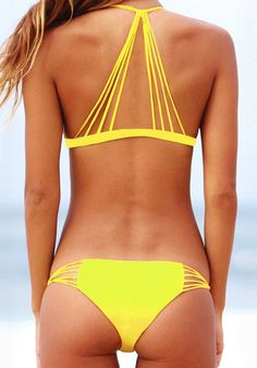 Break the norm with this caged yellow bikini set. It features a halter neck with interlocking string design at the back, while the bikini bottom offers minimal back coverage. | Lookbook Store Swimwear