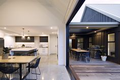 The interaction between the spaces is perfect for entertaining and an active family. Calley Homes Loft Spaces, Living Spaces, Exposed Rafters, Chimney Cap, Building Companies, Covered Decks, Bedroom With Ensuite, Polished Concrete, Guest Bedrooms