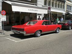 1967 Pontiac GTO,w/ chrome extension tail pipes!  Cool! ( Same as my High School car - Montero Red - except mine had a Black, Vinyl Hardtop )