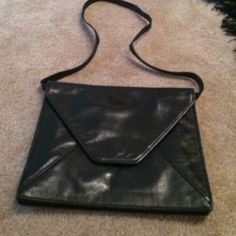 Vintage Fendi black shoulder bag This gorgeous vintage bag is black and the leather has a striped appearance and has the Fendi logo on the snap. The interior is clean and this bag is one of a kind.  FENDI Bags Shoulder Bags