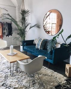 INTERIOR- 1. Interesting color choices. I love how the room is mostly calm colors and then there is a blue couch. 2. the focal point is the couch because the color of it pops.  3. I would change the mirror above the couch and probably put a different piece of art.