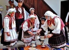 Traditional festive costumes from the Razgrad/Deliorman region (northeastern Bulgaria).  Rural style.  Ethnic group: Kapantsi, which are an old local Christian (Bulgarian Orthodox) ethnographic group.