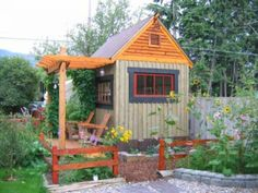 Colorful garden shed with pergola
