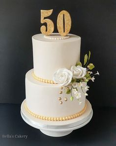A cake to celebrate a milestone birthday. Numerical cake topper and sugar flowers made out of fondant. 50th Birthday Cake For Women, Birthday Cake For Women Elegant, 50th Birthday Gag Gifts, 50th Birthday Cakes, Elegant Birthday Cakes, Birthday Sayings, Wife Birthday, Birthday Images, Birthday Greetings