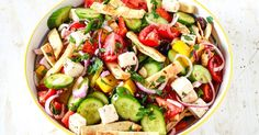 A Panzanella salad made with a tangy dressing, marinated feta cheese, kalamata olive and toasted pita bread. A perfect side for summertime grilling.