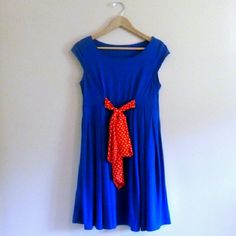Blue mini dress with polka dot bow Minnie Mouse style. Bright blue with red polka dot bow tie. Perfect tailoring. In excellent condition. Dresses Mini