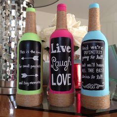 Quote wine bottles made with chalkboard paint.