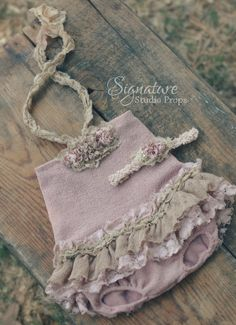 Our Muted Mauve Halter Top Romper is a fun twist on the classic romper design!  Perfect for summer shoots!  The romper is a one piece, and includes the matching headband.  Available in newborn, sitter, and one-year sizes.