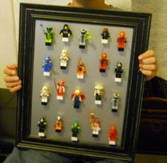 Lego minifigure storage / wall art. men can be popped off the block bases when ready to play and put back on to create wall art.