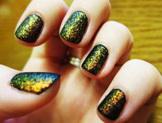 done this sooo many times, black nail polish with an iridescent glitter on top