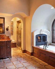 fireplace by the bath tub... Love it!