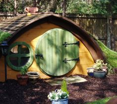 I'm not going to build my kids a treehouse....they get a Hobbit house! Awesome!