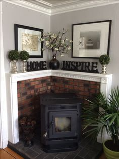 Corner pellet stove. Changed out wall color and added plants,for a summer mantel.