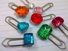DIY~ (great gift idea if giving a book) With a paperclips, strong glue and some craft jewels/stones you can make these easy Blingin' Bookmarks- or they can simply be an ornament of decoration on your notebooks!