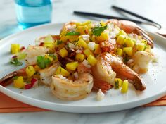 Grilled Shrimp with Mango, Lime and Radish Salsa from FoodNetwork.com.  I have made this, and it is good.