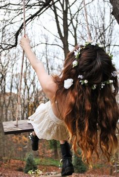 Carefree  fashion hair dress girl outdoors nature flowers swing hipster woods boots
