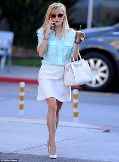 Celebrity street style - Leggy #ReeseWitherspoon catches the eye in a mint top and white skirt as she steps out for coffee