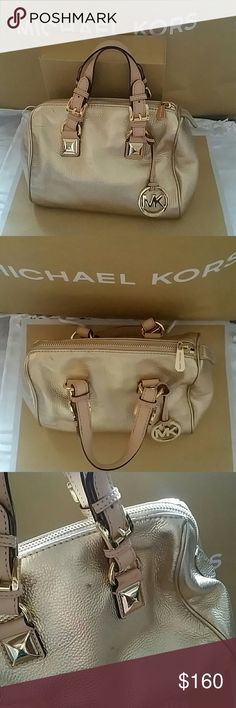Michael Kors Pale Gold Soft Leather small Satchel NEW WITH DEFECTS Michael Kors Small Grayson Satchel *Pale Gold Soft Pebbled Leather *MSRP $298 *Shiny Gold hardware *3 open pockets  *1 zip top pocket *Zip top closure *Michael Kors Hangtag charm *Size/Small *Style/ Grayson style Satchel *Note: Leather is a Natural Product and not always perfect. Can have Natural Distinctive Characteristics, such as Tiny Markings, Creasing, Etc. These are not considered defects, but only the Natural…