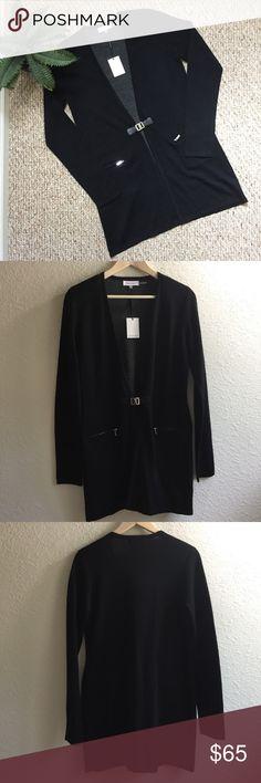 "Calvin Klein Black Cardigan Calvin Klein Cardigan ✨Size S ✨Black  Material: 46% Wool, 45% Acrylic, 8% Nylon, 1% Spandex Aprox. Measurements: 💞Full Length: 32"" 1/4 💞Shoulder to Neck: 4""1/2 💞Sleeves: 27"" Calvin Klein Sweaters Cardigans"