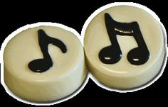 chocolate dipped Oreo cookies with a music note on each.