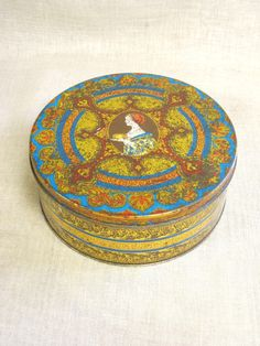 This is a lovely Vintage Tin originally for a Hostess Fruit Cake. This piece is in overall excellent vintage condition, with definite signs of age and wear, with a rich aged patina. Perfect for a collection, or all kinds of storage. An ornate design and rich color give this piece lots of
