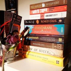 Our Bedside Shelf with all the current reads and October tbr's :) Starting #Americanah tonight... Can't wait for the weekend!  Oh and that a bucket full of book marks :D  #book #books #bookish #bibliophile #bookspine #menwhoread #igreads #goodreads #education #literature #love #booksonbooksonbooks #bookstack #read #arab #readers #tbr #bookworm #bookstagram #instagram #instagramhub #bookshelf #bookstore #bookporn #wanderlust #jeddah #saudiarabia #africa #america