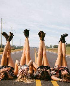 This is a neat picture of friends. The four girls could be centered in the middle of the road