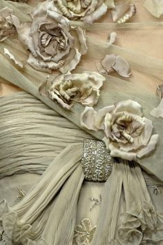 Details of a haute couture dress - appears vintage but attributed to Valentino - satin roses, sheer fabric, embroidery, beading all in pale beige gray