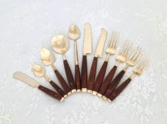 Mid-Century Modern Brass/Nickel Bronze and Rosewood Flatware Set/Service for 12 Plus Hostess Set by EastSideBazaar on Etsy Pickled Olives, Butter Knife, Steak Knives, Flatware Set, Wood Pieces, Mid-century Modern, I Am Awesome, Mid Century, Bronze