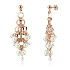 These chandelier earrings present cascading links and faux pearls interlaced with an edgy elegance. Made of rose-gold-tone brass. Set with round white faux pearl. Earrings measure 2.5 inch in length, 1 inch in width. Posts with butterfly backs.