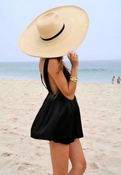 Take glamour to the beach with over-sized hats 1960's style.