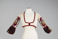 20-11-11  Bodice                                                                                      Date:                                        fourth quarter 19th century                                                          Culture:                                        Greek                                                          Medium:                                        linen, silk, metal                                                          Dimensions…