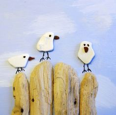 Seagulls made from sea pottery, sea glass and driftwood found along the Cornish coast.