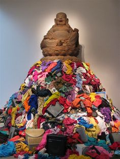 This Buddha sitting on top of a pile of old rags, clothes and electronic materials is by Michelangelo Pistoletto. Buddhism tells us that there is suffering because of desire. Craving pleasure and material goods causes suffering because these desires can never be satisfied.