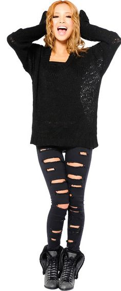Boots, ripped pants, sparkly oversized sweater. Perfect winter casual outfit.
