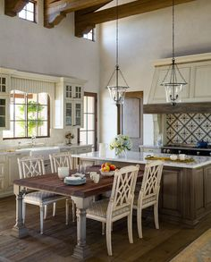 To create visual interest in the kitchen, Scodro had a custom peninsula table made a little lower than the island so everything wasn't the same height.Unique hand painted concrete tiles above the range bring additional texture and detail.