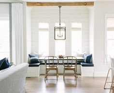 fabulous dining nook, black lantern, timber beams, shiplap walls, navy leather…