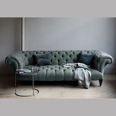 My chesterfield is actually tan? taupe? leather...but I adore this color and the demurely sexy legs. http://shop.canvashomestore.com/products/chesterfield-sofa
