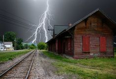 ***Spooky: Lightening strikes behind an abandoned building by the railway (Calumet, Quebec) by axiepics E