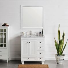 """The Acclaim 30"""" Vanity in white is a gorgeous vanity featuring a white Carrara marble countertop with a white porcelain undermount sink, solid wood construction, durable water-resistant polyurethane finish, and water-resistant layer inside. Starting at $1,399 there is plenty of storage with soft closing drawers and doors and brushed chrome handles/knobs."""