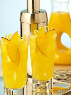 The Sweet Escape ~ 1 ounce fresh mango puree.  1 1/2 ounce vodka.  1 ounce fresh lemon juice.  1 ounce simple syrup.  2 ounces chilled soda water.  mango slices & lemon spiral for garnish.