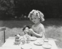 "Shirley Temple playing with her first doll, a Volland Raggedy Ann. Doll and photo to be featured in Theriault's Auction, ""Love, Shirley Temple"", July 14, 2015. http://www.theriaults.com"